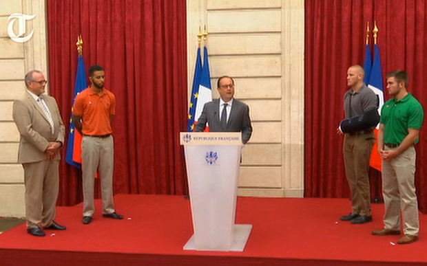French President Francois Hollande (L) welcomes Belgian Prime Minister Charles Michel to a reception at the Elysee Palace in Paris, in honor of the three young Americans and a British man with the country's top Legion d'Honneur medal in recognition of their bravery after they overpowered the train attacker.
