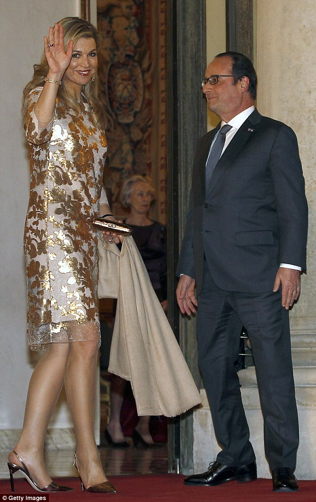 The Queen wore gold for the state dinner held by French leader Francois Hollande tonight during her two-day state visit to France