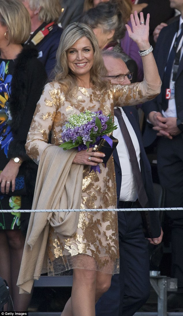 Queen Maxima stunned in a glitzy golden gown as she attended the Liberation Day Concert in Amsterdam