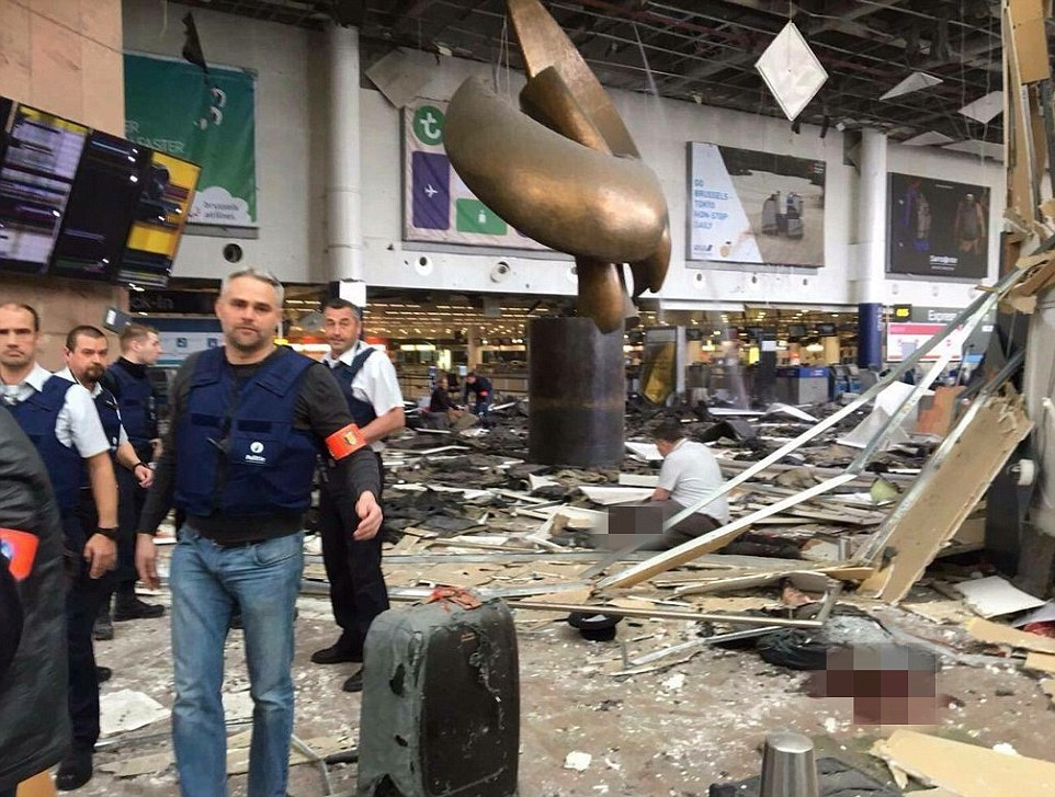 Carnage: At least eleven people have died and several injured after two explosions rocked Brussels Airport in a suspected terror attack