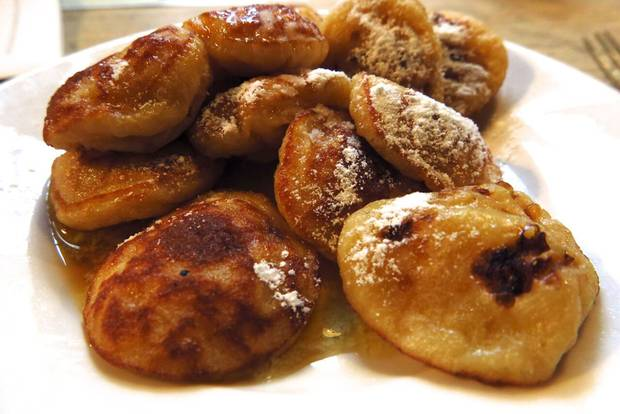 Puffy poffertjes pancakes are among the dishes you'll taste on an Eating Amsterdam walking tour of the hip Jordaan neighbourhood