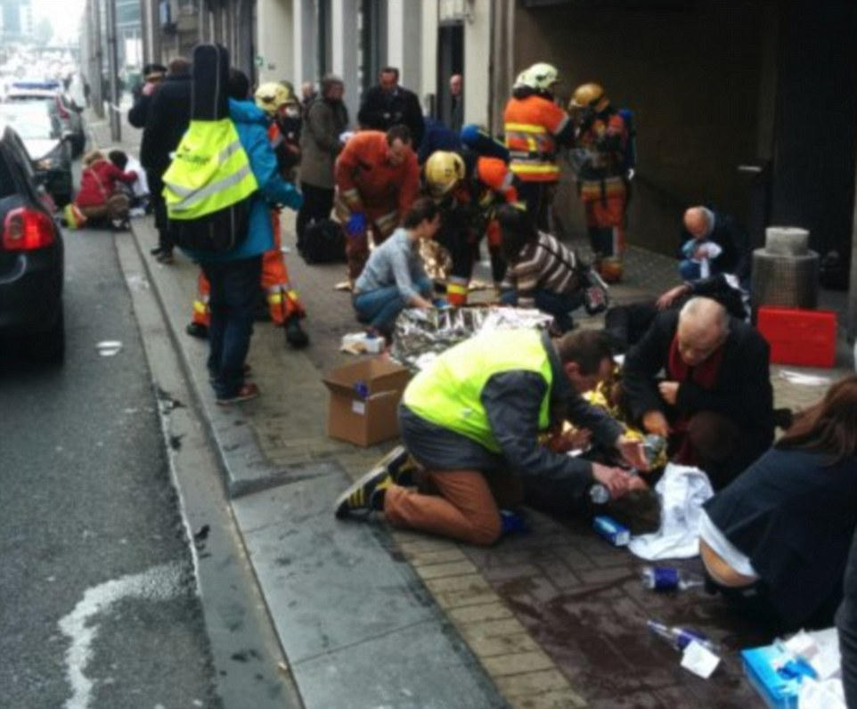 Bravery: People are treated, comforted and given water by the emergency services as they help the wounded