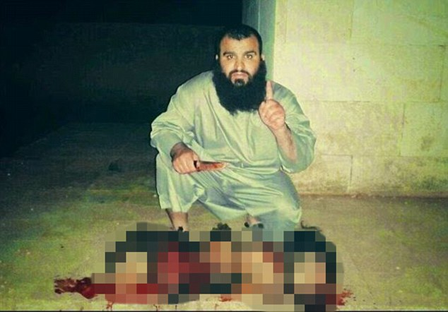 Terrorist: The man pictured posing alongside the suspended men is believed to be Abu Al-Rahman