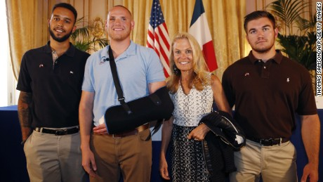 From left: Anthony Sadler, Spencer Stone, Alek Skarlatos and US ambassador to France Jane Hartley pose after a press conference at the US embassy in Paris on August 23, 2015.