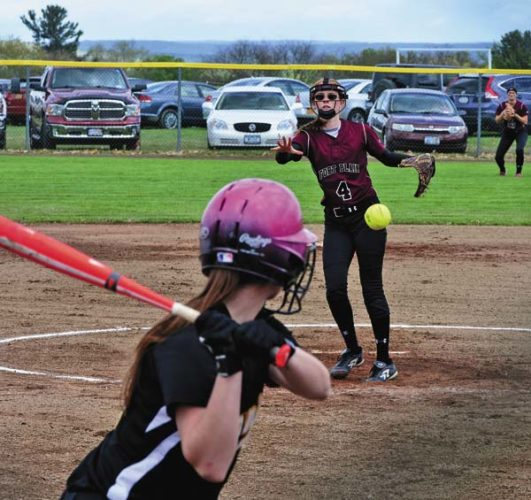 Fort Plain's Michaela Stockwell (4) pitches to Canajoharie's Hannah Smith during Monday's Western Athletic Conference game. The Hilltoppers were seeded fourth in the Section II Class D Tournament, while the Cougars earned the 10th seed in Class C. (The Leader-Herald/Bill Trojan)